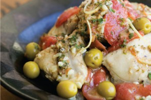 Country chicken with tomatoes and olives.
